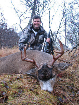 Jason Eliam sitting behind his Sitka Blacktail
