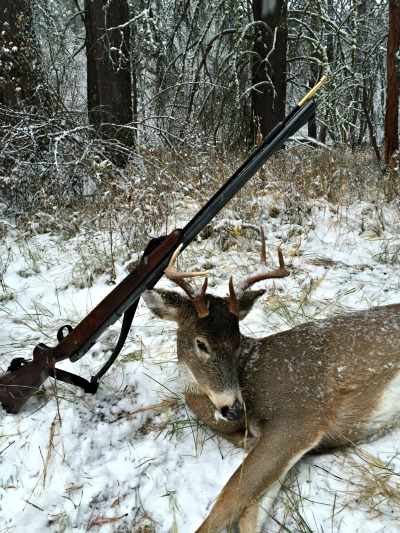 Deer hunting - GLO - 12-19 - Gun on Antlers - optimized.jpg